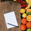 Shopping list and fresh fruits — Stock Photo