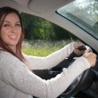 Happy woman driving a car — Stock Photo
