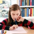 Little girl doing her school homework — Foto Stock
