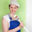 Young female painter with paintbrush — Stock Photo