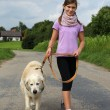 Girl walking her dog — Stok fotoğraf