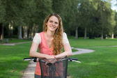 Woman on a bike in a park — Stock Photo