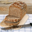 Foto Stock: Whole wheat bread on wooden board