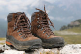 Hiking boots in the mountains Alps — 图库照片