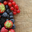 Foto Stock: Fresh berries on wooden board
