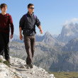 Young men hiking in the mountains — Stock Photo
