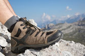 Hiking boots of a hiker in the mountains — Stock Photo