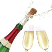 Popping cork from a Champagne bottle — Stock Photo