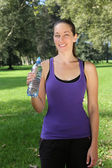Young woman with drinking bottle during sports or jogging — Stock Photo