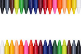 Crayons for children forming a frame — Foto Stock