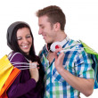 Stock Photo: Young couple having fun while shopping