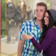 Stock Photo: Young couple doing window shopping in mall