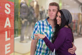 Young couple doing window shopping in a mall — Stok fotoğraf