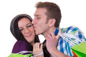 Young couple kissing while shopping, love topic — Stockfoto