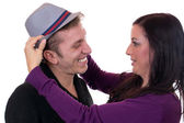 Couple trying on a hat while shopping — Stock Photo