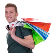 Casual man with headphones and shopping bags — Photo