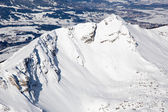 High mountain peak covered with snow in winter — Stock Photo