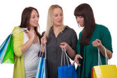 Group of young women with shopping bags talking about their purc — Stock Photo
