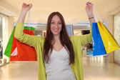 Happy young woman with shopping bags having fun while shopping i — Stock fotografie