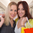 Happy friends having fun while shopping in a mall — Stock Photo #43070219