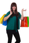 Smiling young woman with shopping bags having fun — Stockfoto