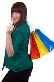Smiling woman with credit card and shopping bags — Stock fotografie