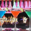 Colorful cocktails in Martini glasses in a bar — Stock Photo