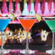 Colorful cocktails in Martini glasses in a bar — Stock Photo #43887005