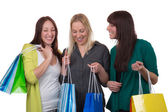 Group of young women shopping, isolated — Stock Photo
