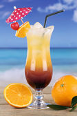 Tequila Sunrise cocktail drink at the sea — 图库照片