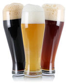 Three different beer with foam — Stockfoto