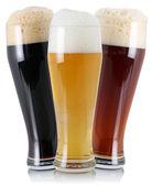 Three different beer with foam — Zdjęcie stockowe