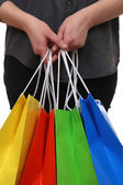 Person holding shopping bags — Stok fotoğraf