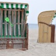 Roofed wicker beach chairs — Stock Photo