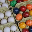 White eggs and easter eggs — Stock Photo #23980989