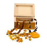 Amber jewelry and wooden box isolated on white — Stock Photo