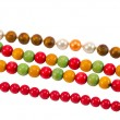 图库照片: Pearl colorful wooden bead jewelry chain on white