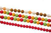 Pearl colorful wooden bead jewelry chain on white — Stock Photo