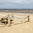 Rope log fence beach sand table bench waste bin — Stock Photo
