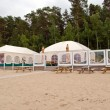 Restaurant bar tents on seaside sand — Stock Photo