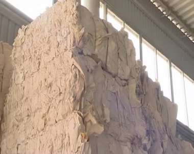 Huge pile of pressed paper placed in warehouse. — Stock Video