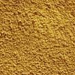 Yellow painted textured wall closeup. — Stock Photo