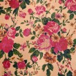 Blooming red roses on the wall of wallpaper designs. — Stock Photo #13178704