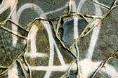 Closeup graffiti pinta parede de alvenaria concreto retrô — Foto Stock