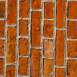 Wall built of red brick architectural details. — Stock Photo