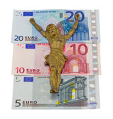 Concept gold jesus crucify euro banknotes isolated — Stock Photo