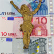 Stock Photo: Concept gold jesus crucify on euro banknotes