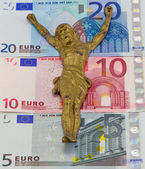 Concept gold jesus crucify on euro banknotes — Stock Photo