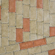 City sidewalk lined with small tile background — Stock Photo