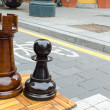 Outdoor chess game figures near bicycle path — Stock Photo